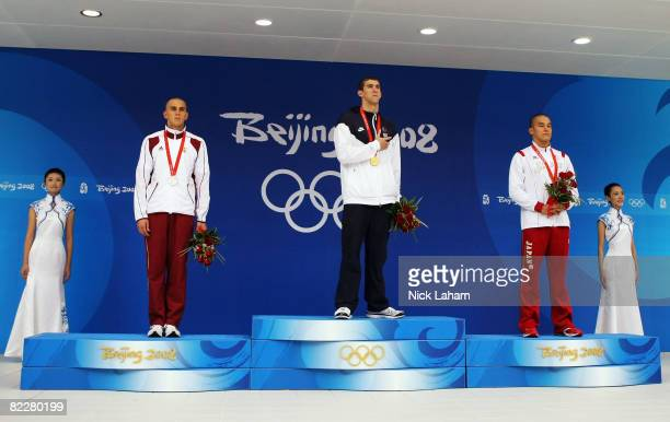 Silver medalist Laszlo Cseh of Hungary gold medalist Michael Phelps of the United States and bronze medalist Takeshi Matsuda of Japan stand on the...