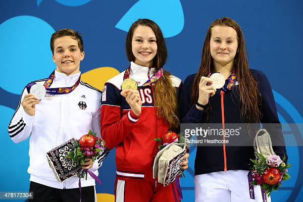 Silver medalist Laura Kelsch of Germany gold medalist Maria Astashkina of Russia and bronze medalist Herve Nolwenn of France pose on the podium...