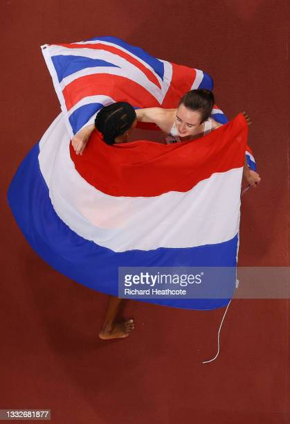 Silver medalist Laura Muir of Team Great Britain and bronze medalist Sifan Hassan of Team Netherlands embrace following the Women's 1500m Final on...