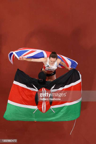 Silver medalist Laura Muir of Team Great Britain and gold medalist Faith Kipyegon of Team Kenya embrace following the Women's 1500m Final on day...