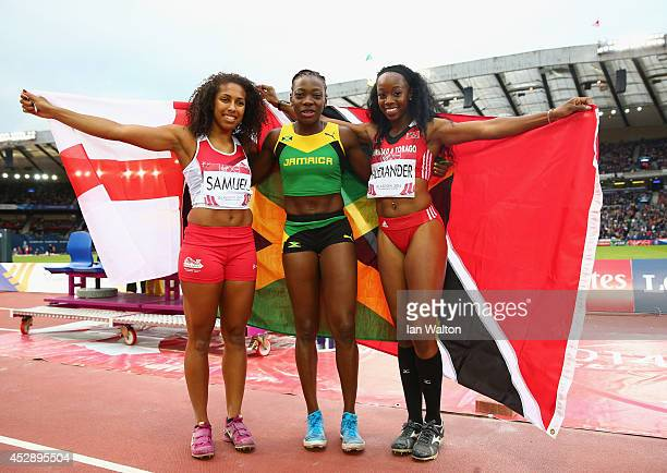Silver medalist Laura Samuel of England, gold medalist Kimberly Williams of Jamaica and bronze Ayanna Alexander of Trinidad and Tobago celebrate...