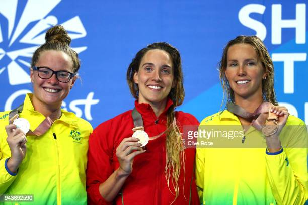 Silver medalist Laura Taylor of Australia gold medalist Alys Thomas of Wales and bronze medalist Emma McKeon of Australia pose during the medal...