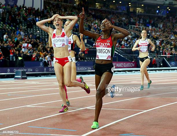 Silver medalist Laura Weightman of England and gold medalist Faith Kibiegon of Kenya react as they cross the finish line in the Women's 1500 metres...