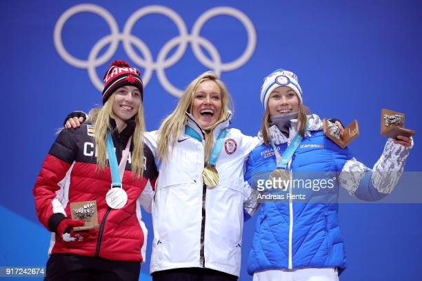 Silver medalist Laurie Blouin of Canada gold medalist Jamie Anderson of the United States and bronze medalist Enni Rukajarvi of Finland pose during...