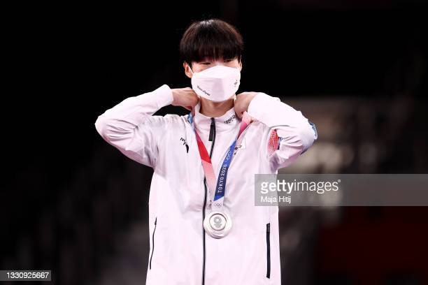 Silver medalist Lee Da-bin of Team South Korea adjusts her medal for the Women's +67kg Taekwondo on day four of the Tokyo 2020 Olympic Games at...