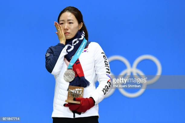 Silver medalist Lee Sanghwa of South Korea shows her emotion during the medal ceremony for Speed Skating Ladies' 500m on day 11 of the PyeongChang...