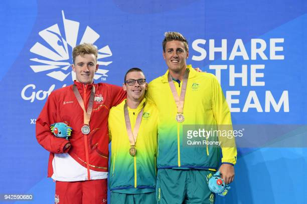 Silver medalist Lewis White of England gold medalist Timothy Disken of Australia and bronze medalist Brenden Hall of Australia pose during the medal...