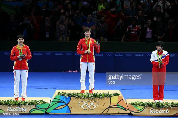 Silver medalist Li Xiaoxia of China gold medalist Ding Ning of China and bronze medalist Kim Song I of North Korea pose on the podium after the...