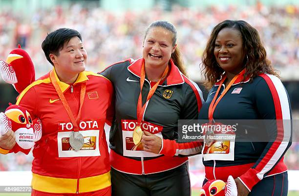 Silver medalist Lijiao Gong of China, gold medalist Christina Schwanitz of Germany and bronze medalist Michelle Carter of the United States pose on...