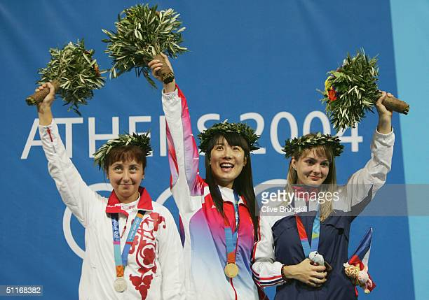Silver medalist Lioubov Galkina of Russia gold medalist Li Du of China and bronze medalist Katerina Kurkova of Czech Republic celebrate at the podium...