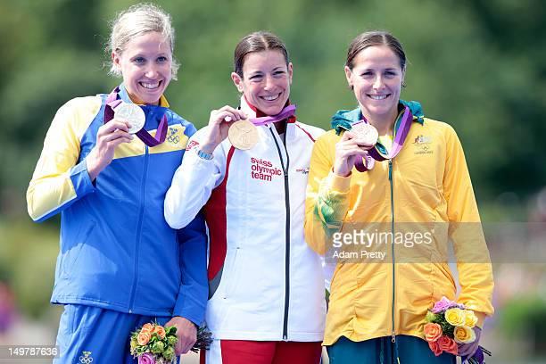 Silver medalist Lisa Norden of Sweden Gold medalist Nicola Spirig of Switzerland and Bronze medalist Erin Densham of Australia pose with their medals...