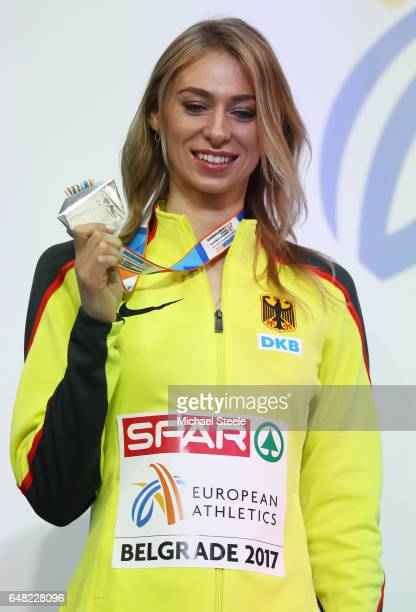 Silver medalist Lisa Ryzih of Germany poses during the medal ceremony for the Women's Pole Vault on day three of the 2017 European Athletics Indoor...