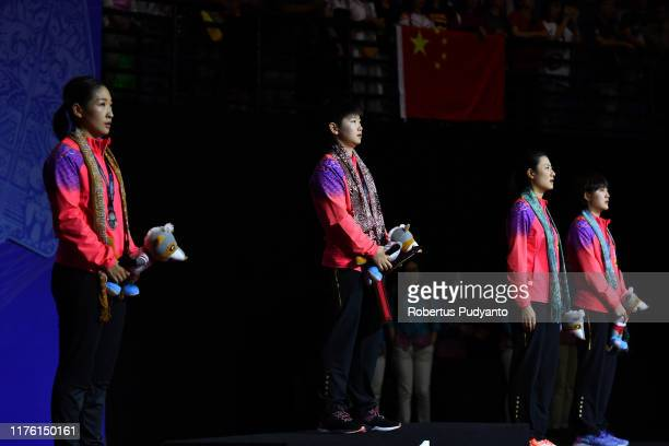 Silver medalist Liu Shiwen of China, gold medalist Sun Yingsha of China, bronze medalist Ding Ning and Chen Meng of China celebrate on the podium...