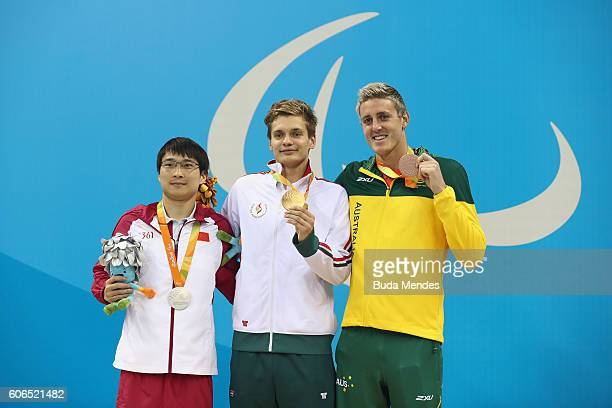 Silver medalist Liu Xiaobing of China Gold medalist Tamas Toth of Hungary and Bronze medalist Brenden Hall of Australia pose on the podium at the...