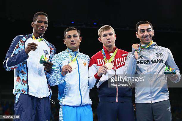 Silver medalist Lorenzo Sotomayor Collazo of Azerbaijan gold medalist Fazliddin Gaibnazarov of Uzbekistan and bronze medalists Vitaly Dunaytsev of...