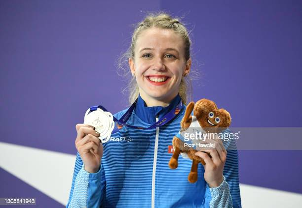 Silver medalist Lotta Kemppinen of Finland poses for a photo during the medal ceremony for Women's 60 metres during the second session on Day 3 of...