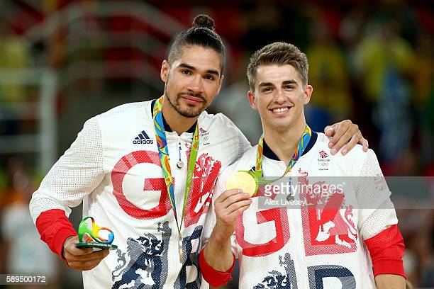 Silver medalist Louis Smith and gold medalist Max Whitlock of Great Britain pose for photographs on the podium at the medal ceremony for Men's Pommel...