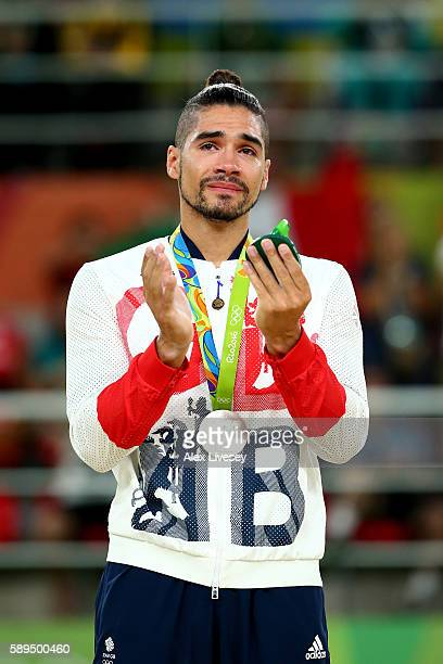 Silver medalist Louis Smith of Great Britain celebrates on the podium at the medal ceremony for the Men's Pommel Horse Final on Day 9 of the Rio 2016...