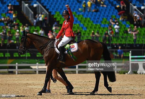 Silver medalist Lucy Davis of United States riding Barron celebrates before the medal ceremony after the Jumping Team competition on Day 12 of the...