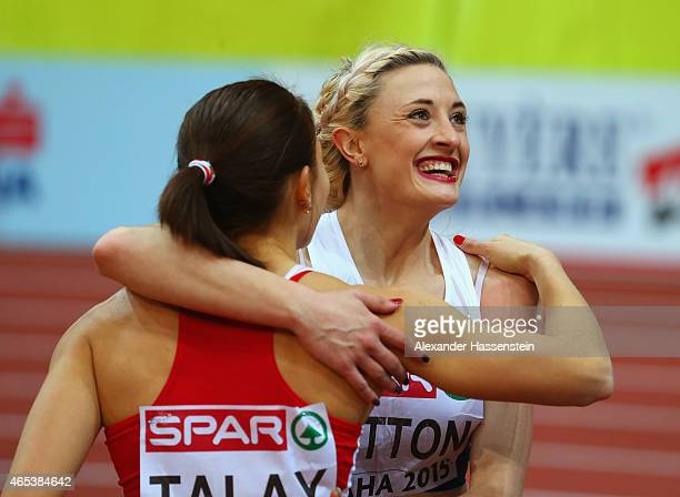 Silver medalist Lucy Hatton of Great Britain Northen Ireland celebrates with gold medalist Alina Talay of Belarus after the Women's 60 metres final...