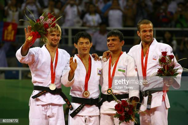 Silver medalist Ludwig Paischer of Austria, gold medalist Choi Minho of South Korea, bronze medalist A Rishod Sobirov of Uzbekistan and bronze...