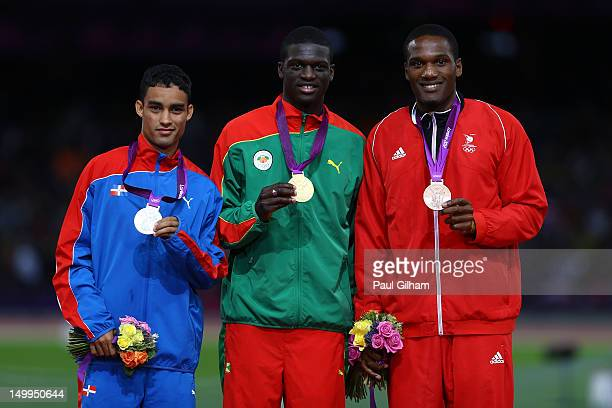 Silver medalist Luguelin Santos of Dominican Republic gold medalist Kirani James of Grenada and bronze medalist Lalonde Gordon of Trinidad and Tobago...