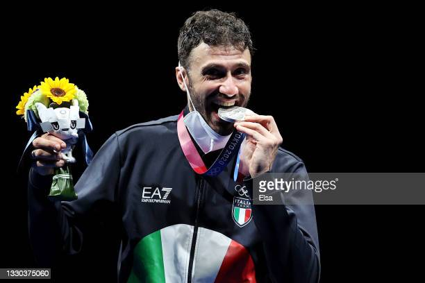 Silver medalist Luigi Samele of Italy poses on the podium during the men's sabre individual medal ceremony of the fencing on day one of the Tokyo...