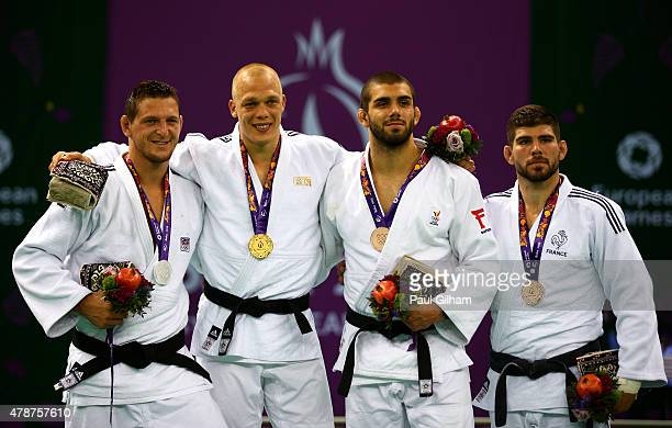 Silver medalist Lukas Krpalek of the Czech Republic gold medalist Henk Grol of the Netherlands and bronze medalists Toma Nikiforov of Belgium and...