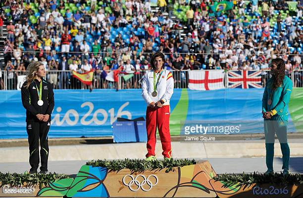 Silver medalist Luuka Jones of New Zealand gold medalist Maialen Chourraut of Spain and bronze medalist Jessica Fox of Australia stand on the podium...