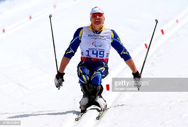 Silver medalist Lyudmyla Pavlenko of Ukraine crosses the finish line in the Women's Cross Country 5km Sitting on day nine of the Sochi 2014...