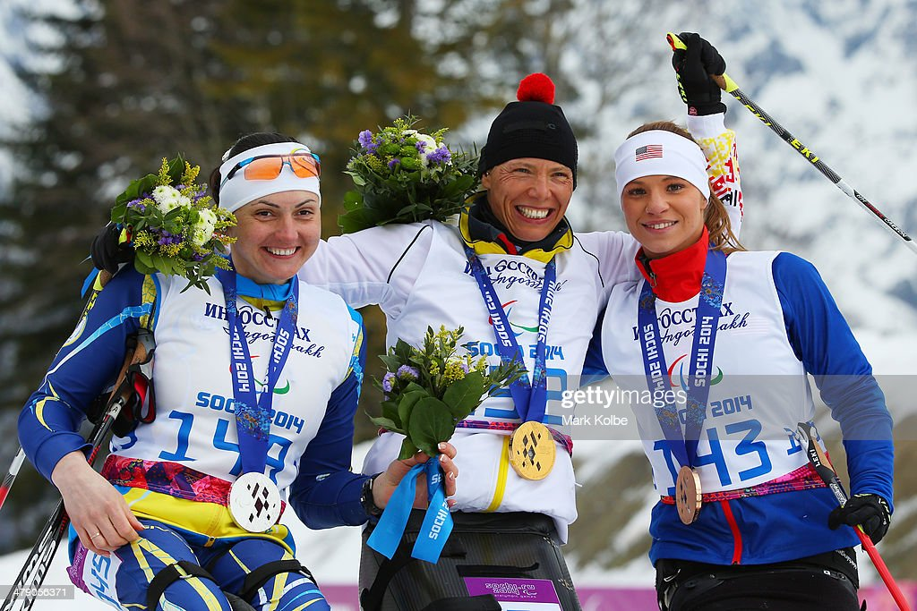 Silver medalist Lyudmyla Pavlenko of Ukraine, gold medalist Andrea Eskau of Germany and bronze medalist Oksana Masters of the United States pose during the medal ceremony for the Women's Cross Country 5km - Sitting on day nine of the Sochi 2014 Paralympic Winter Games at Laura Cross-country Ski and Biathlon Center on March 16, 2014 in Sochi, Russia.