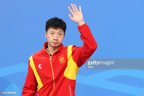 Silver medalist Ma Long of Beijing reacts on the podium after the Men's Table Tennis Group Final Match against Guangdong during China's 14th National...