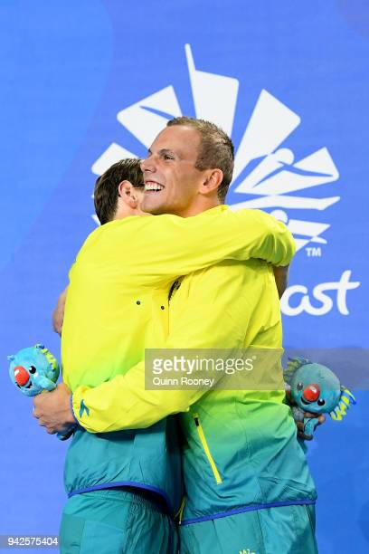 Silver medalist Mack Horton of Australia and gold medalist Kyle Chalmers of Australia embrace during the medal ceremony for the Men's 200m Freestyle...