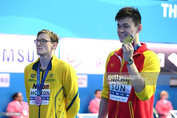 LR Silver medalist Mack Horton of Australia and gold medalist Sun Yang of China competes in the *** on day one of the Gwangju 2019 FINA World...