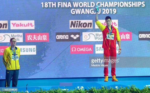 Silver medalist Mack Horton of Australia and gold medalist Sun Yang of China pose during the medal ceremony for Men's 400m Freestyle Final on day one...