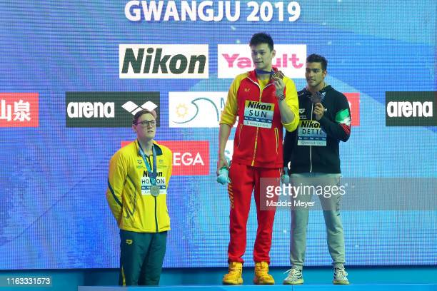 Silver medalist Mack Horton of Australia gold medalist Sun Yang of China and bronze medalist Gabriele Detti of Italy pose during the medal ceremony...