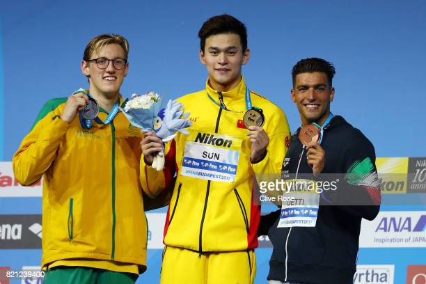 Silver medalist Mack Horton of Australia gold medalist Yang Sun of China and bronze medalist Gabriele Detti of Italy pose with the medals won in the...