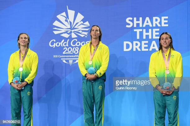 Silver medalist Madeline Groves of Australia gold medalist Emma McKeon of Australia and bronze medalist Brianna Throssell of Australia pose during...