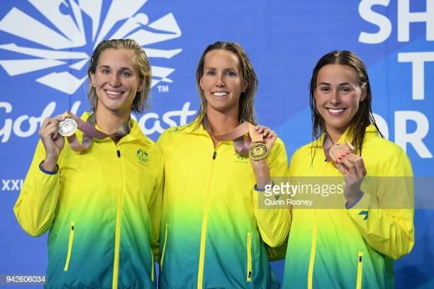 Silver medalist Madeline Groves of Australia gold medalist Emma McKeon of Australia and bronze medalist Brianna Throssell of Australia pose during...