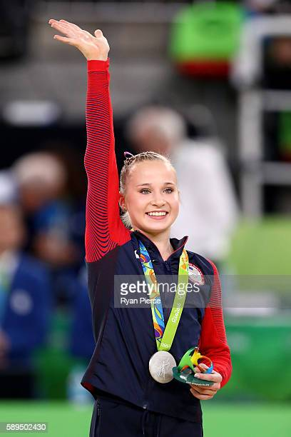 Silver medalist Madison Kocian of the United States celebrates on the podium at the medal ceremony for the Women's Uneven Bars on Day 9 of the Rio...
