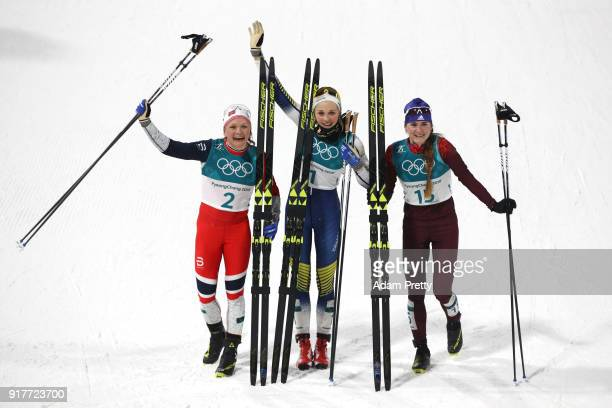 Silver medalist Maiken Caspersen Falla of Norway, gold medalist Stina Nilsson of Sweden and Yulia Belorukova of Olympic Athlete from Russia celebrate...