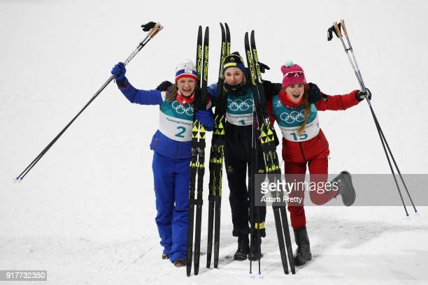 Silver medalist Maiken Caspersen Falla of Norway gold medalist Stina Nilsson of Sweden and Yulia Belorukova of Olympic Athlete from Russia celebrate...