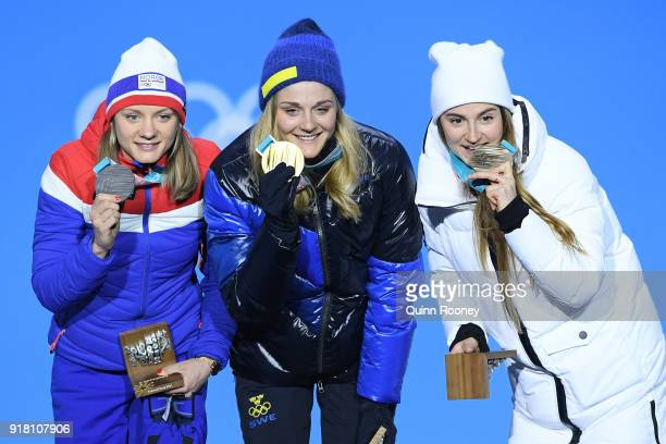Silver medalist Maiken Caspersen Falla of Norway gold medalist Stina Nilsson of Sweden and bronze medalist Yulia Belorukova of Olympic Athlete from...