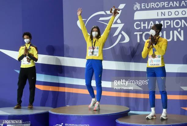 Silver medalist Malaika Mihambo of Germany, gold medalist Maryna Bekh-Romanchuk of Ukraine and bronze medalist Khaddi Sagnia of Sweden react during...
