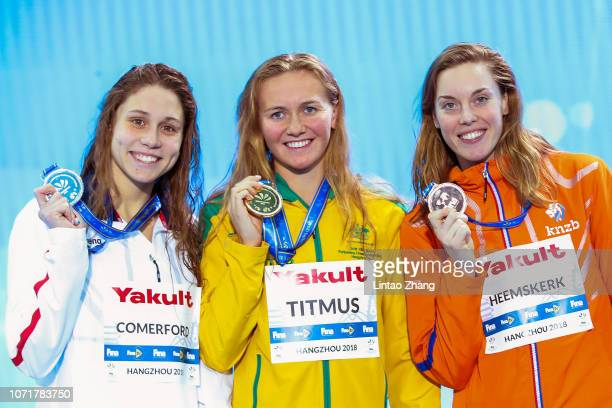 Silver medalist Mallory Comerford of the United States gold medalist Ariarne Titmus of Australia and bronze medalist Femke Heemskerk of the...
