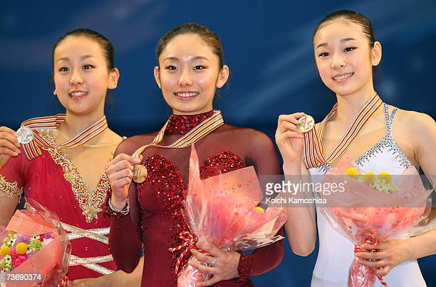 Silver medalist Mao Asada of Japan Gold medalist Miki Ando of Japan and Bronze medalist YuNa KIM of South Korea pose after the medals ceremony during...