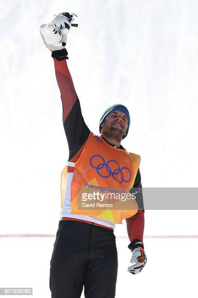 Silver medalist Marc Bischofberger of Switzerland celebrates on the podium following the Freestyle Skiing Men's Ski Cross Big Final on day 12 of the...