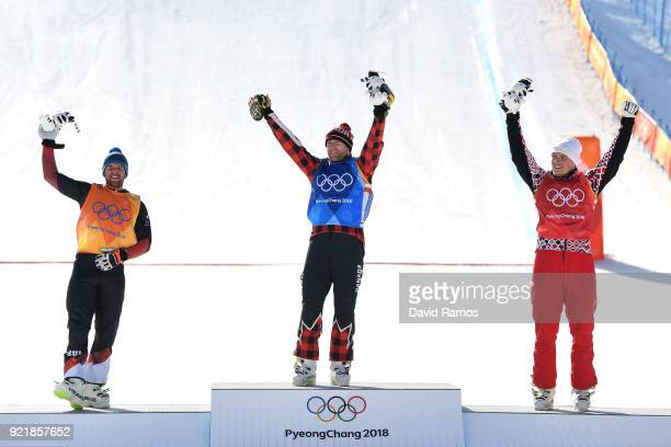 Silver medalist Marc Bischofberger of Switzerland gold medalist Brady Leman of Canada and bronze medalist Sergey Ridzik of Olympic athletes of Russia...