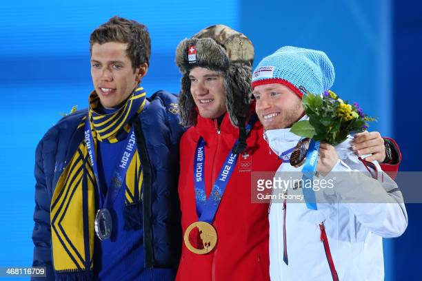 Silver medalist Marcus Hellner of Sweden gold medalist Dario Cologna of Switzerland and bronze medalist Martin Johnsrud Sundby of Norway pose on the...