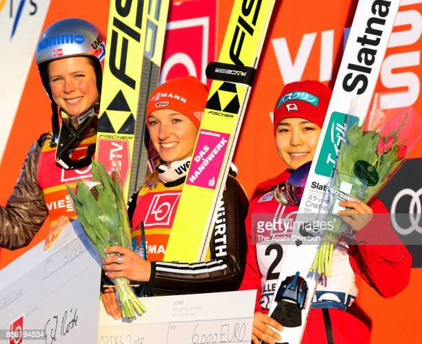 Silver medalist Maren Lundby of Norway gold medalist Katharina Althaus of Germany and bronze medalist Sara Takanashi of Japan poses on the podium...